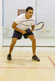 Hispanic man playing squash