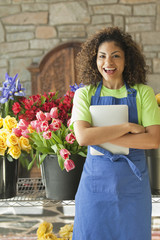 Mixed race florist holding digital tablet