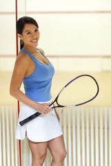 Woman holding squash racquet