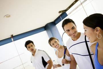 Hispanic couples on squash court