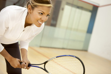 Hispanic woman playing squash