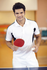 Hispanic man playing ping pong