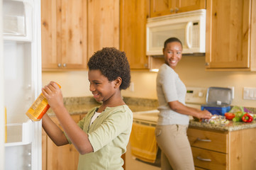African American mother and daughter in kitchen