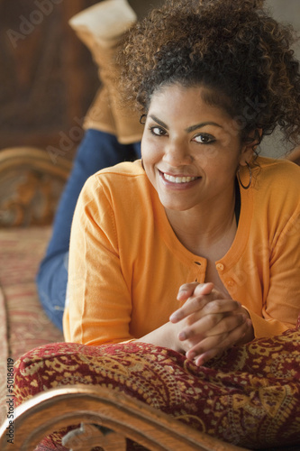 Mixed race woman laying on sofa