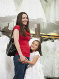 Mixed race mother and daughter in dress store