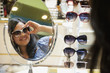 Mixed race woman shopping for sunglasses