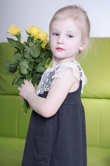 Beutiful girl with yellow roses