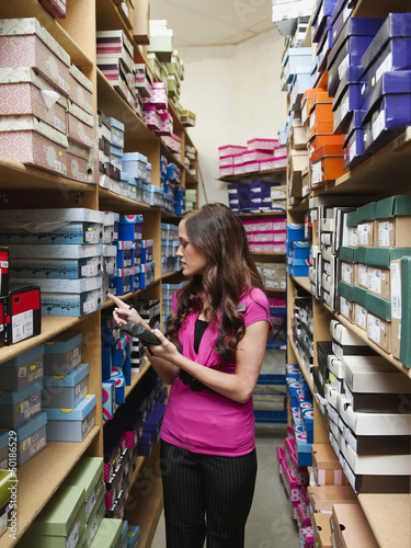 Caucasian woman working in stockroom
