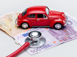 Car with stethoscope and money to show the cost increase