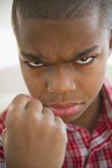 African American boy frowning and making a fist
