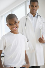 African American boy having checkup with doctor
