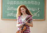 Mixed race student holding violin
