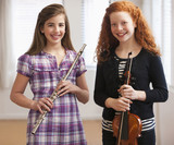 Girls holding musical instruments