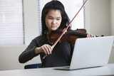 Asian girl playing violin