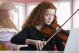 Mixed race girl playing violin