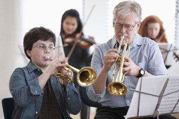 Student playing trumpet with teacher