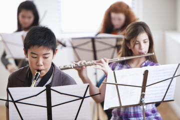 Students playing instruments in music class