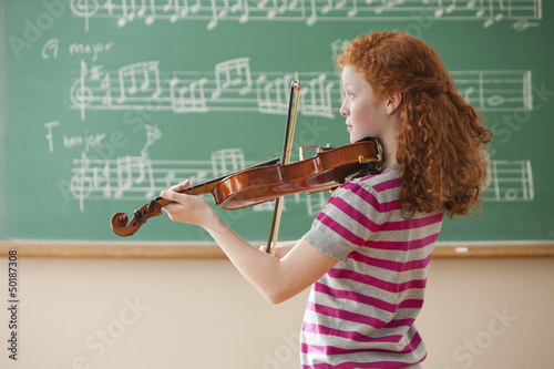 Mixed race student playing violin