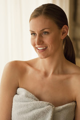 Caucasian woman wrapped in a towel