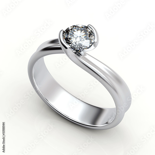 Wedding ring with diamond on white background. Sign of love