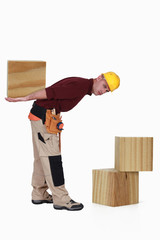Builder with large blocks of wood