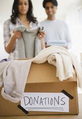 Mixed race couple donating clothing