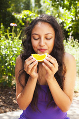 Mixed race teenager eating orange