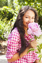 Mixed race teenager holding flower