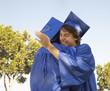 Smiling graduates hugging