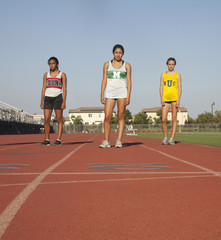 Runners standing together on track