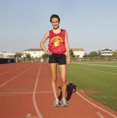 Caucasian runner standing on track