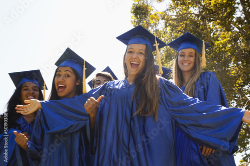 Happy graduates laughing