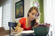 Caucasian teenager doing homework