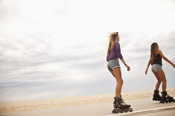 Caucasian teenage girls roller blading