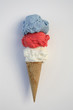 Red, white and blue ice cream in cone