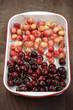 Rainier and bing cherries in pan