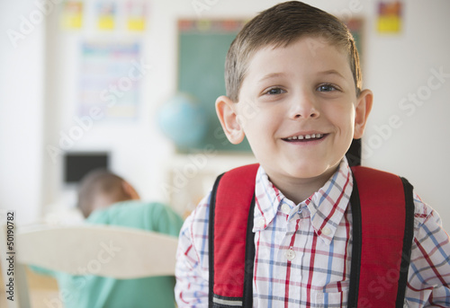 Smiling Caucasian boy in classroom