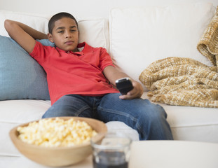 Hispanic boy watching television