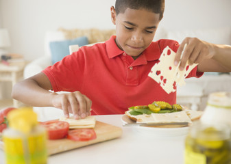 Hispanic boy making sandwich