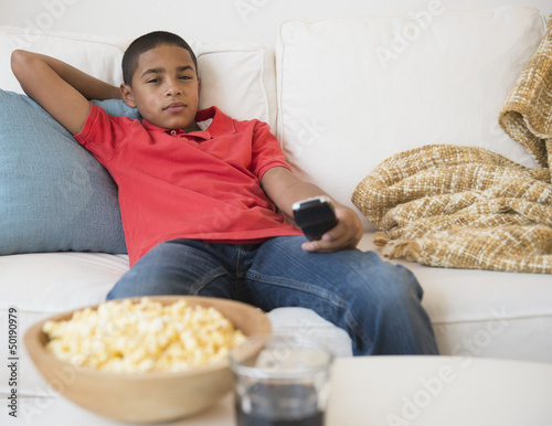 Hispanic boy watching television