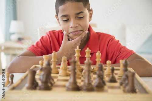 Hispanic boy playing chess