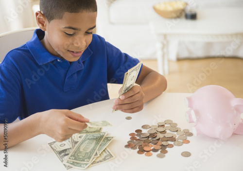 Hispanic boy counting money