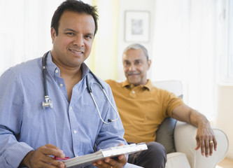 Hispanic doctor examining patient