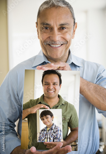 Portraits of Hispanic grandfather, father and son