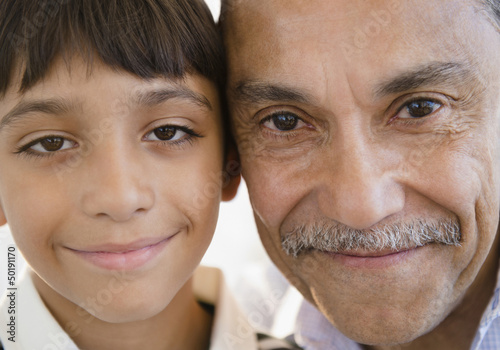 Smiling Hispanic grandfather and grandson