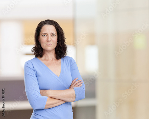 Hispanic woman with arms crossed