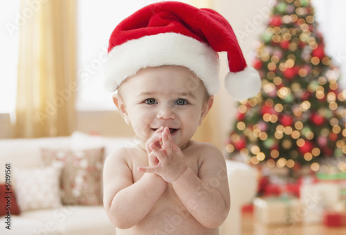Hispanic baby in Santa hat