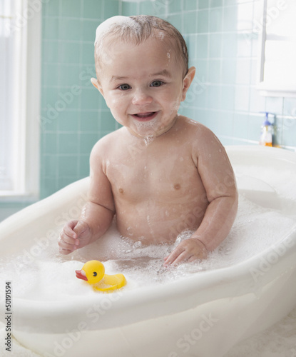 Hispanic baby taking a bath