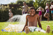 Black boy playing in water