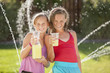Caucasian girls drinking lemonade